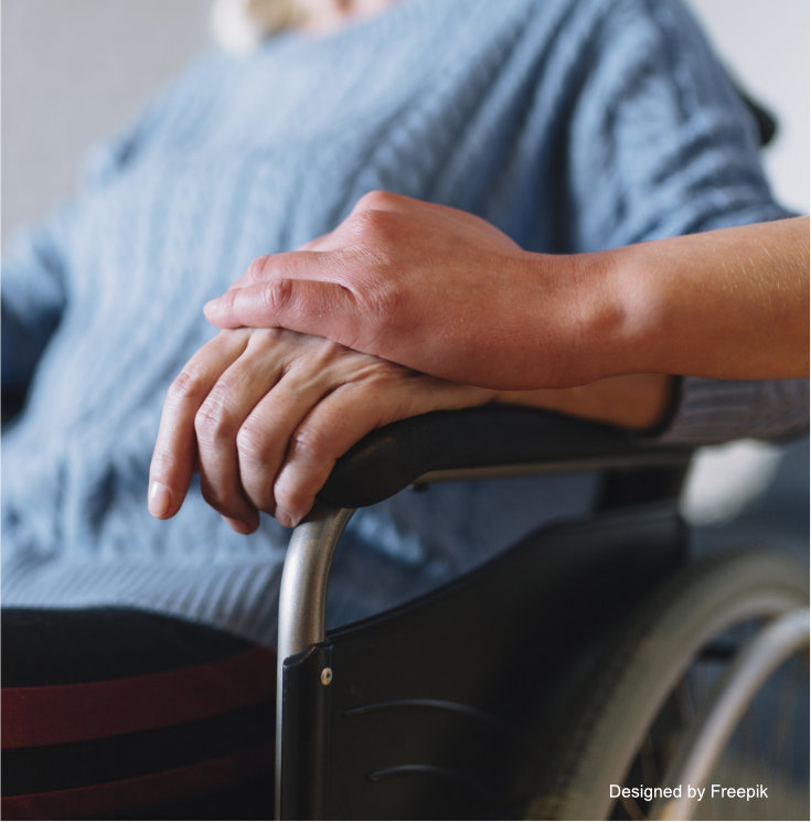 Pflege Frau im Rollstuhl