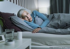 Insomnia - Sleep Disorder. Worried Senior Woman Suffering from Insomnia, Lying in Bed, Staying Awake Late at Night